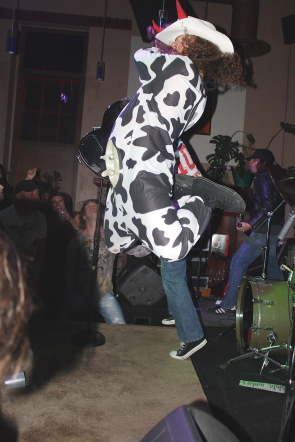 BC DC lead guitarist Mad Cow jumps for rock. Photo by Richard Amery