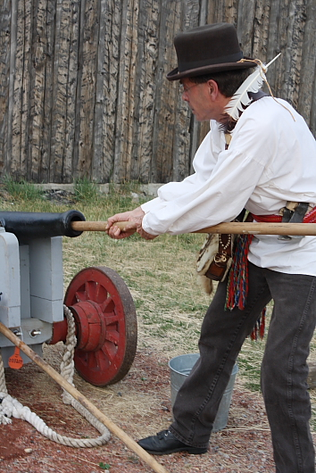 William Gladstone (Ron Hoar) cleans out a cannon. Photo by Richard Amery