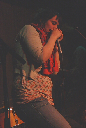 Deadhorse's Jennifer  Crighton blowing some mean harp. Photo by Richard Amery