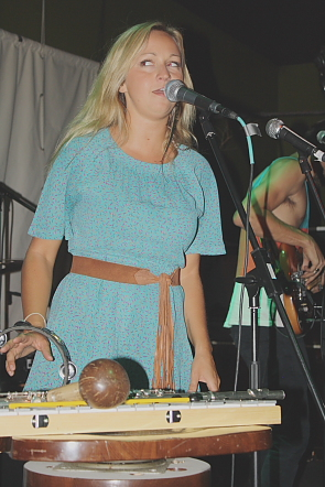 Hey Ocean singer Ashleigh Ball reaches for a percussion instrument. Photo by Richard Amery