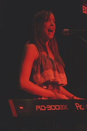 Jenie Thai playing keyboard at the Tongue N Groove. photo by Richard Amery