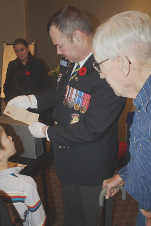 Clarence Cluff looks at one letter  from  John Murray which Service Officer Glenn Miller gave a presentation on at the Galt Museum. Photo by Richard Amery