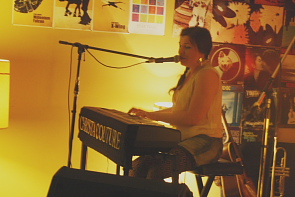 Christa Couture plays a solo set on piano. Photo by Richard Amery