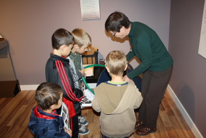 Galt museum curator Wendy Aitkens helps visitors examine 'artifacts' form the '50s. Photo by Richard Amery