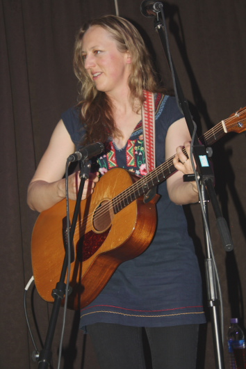 Ana Egge sharing stories and music. Photo by Richard Amery