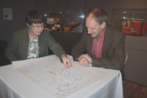 Galt Museum curator Wendy Aitkens and Roy W Golsteyn work on a puzzle of a map of Lethbridge. Photo by Richard Amery