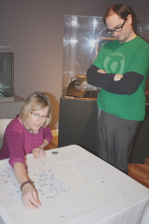 Chris Roedler watches  Anine Vonkeman put together a puzzle in the Galt's science exhibit. Photo by Richard Amery