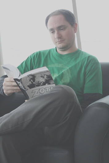 Chris Roedler reads Scott McCloud's Zot!. Photo by Richard Amery