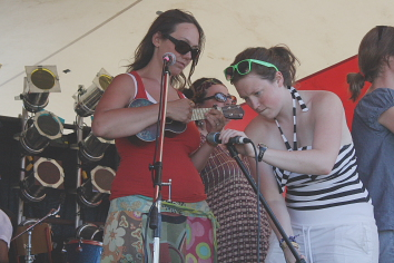Jana MacKenzie  gets some help tuning her ukulele during last year's South Country Fair. Photo By Richard Amery