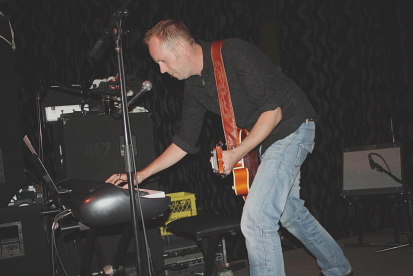 Tod Robinson playing keyboards and guitar. Photo by Richard Amery