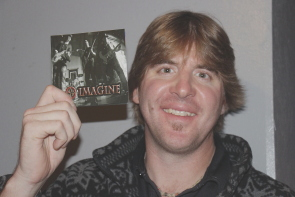 "Greg Gomola is proud of Zojo Black's new CD ""Imagine."" Photo by Richard Amery"