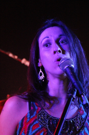Andi Roberts singing at a funderaiser for Maggie hall;s siter, Nov. 3 at KCs Pub in Coaldale. photo by Richard Amery