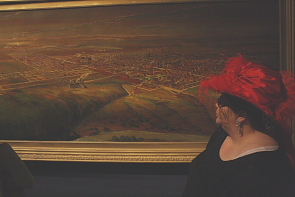 Belinda Crowson examines a paining of Lethbridge from 1912. Photo by Richard Amery