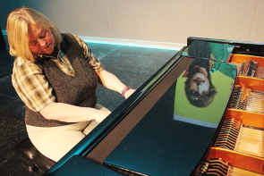 Bente Hansen practices playing Let it Be as Jess Plessis is reflected on her piano.  Photo by Richard Amery