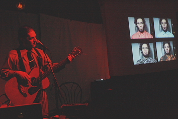 Bob Wiseman singing with himself on screen. Photo by Richard Amery