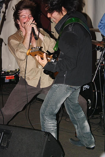 Yuri Ihari and Rotten Dan work up a sweat at the Slice, Sept. 14. Photo by Richard Amery