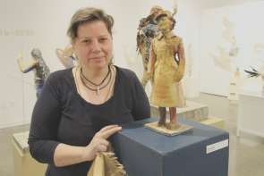 Artist Jamie Hume and her sculpture of her grandmother. Photo by Richard Amery
