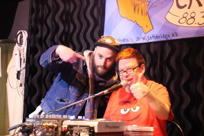 CKXU station Manager Aaron Trozzo and Murray at the Fundrive Round up at the Slice, celebrating raising $22,225 this year. Photo by Richard Amery