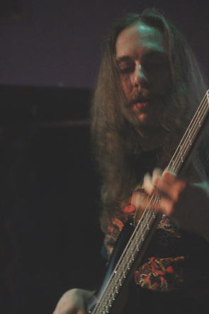 Black Thunder bassist Dustin Wiebe playing the Slice for Electric Eye. Photo by Richard Amery