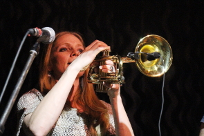 Eli and the Straw Man's Tam Maiuri playing a trumpet solo at the Slice, April 17. Photo by Richard Amery