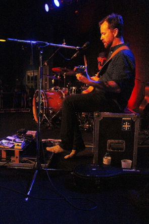 Elliott Brood's Casey Laforet does double duty on guitar and bass pedals at Average Joes, May 4. photo by Richard Amery