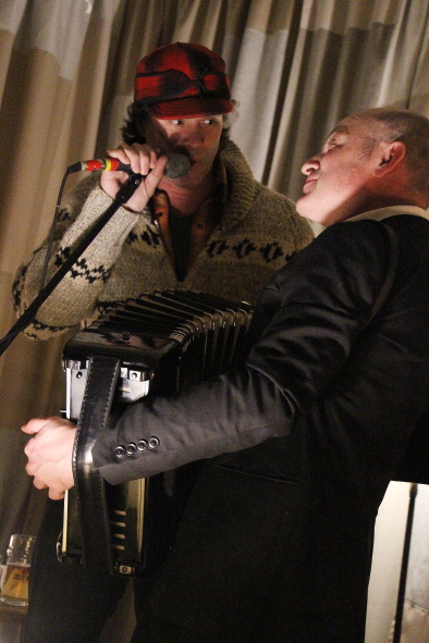 Corb Lund joins Geoff Berner on Stage during his encore at the owl Acoustic lounge, March 29. Photo by Richard Amery
