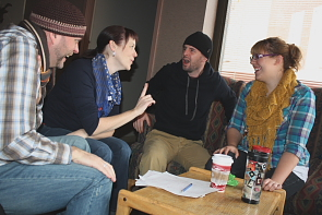 Scott Carpenter, Erica Hunt, Jay Whitehead and Jocelyn Haub pore over a script. Photo by Richard Amery