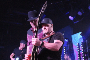 Gord Bamford admires a guitar solo at Average Joes, Nov. 6. photo by Richard Amery