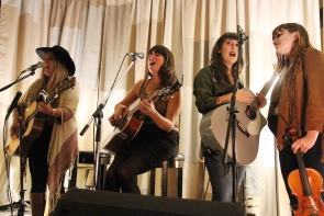 Jenny allen, Kimberley MacGregor and october Poppy singing in the round. photo by Richard amery