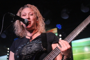 Lisa Dodd playing bass with Gord Bamford. Photo by Richard Amery