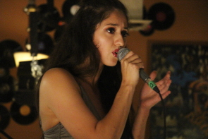 Lisette Xavier performiung at the Owl Acoustic lounge. photo by Richard Amery