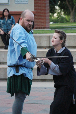 Macbeth (DJ Gellatly) battles young Siward (Chelsey Fitzsimons) in Shakespeare in the Park's production of Macbeth, running July 4-Aug. 9 in Galt Gardens. photo by Richard Amery