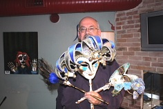 Blaine Greenwood shows off a few of his masks. Photo By Richard Amery