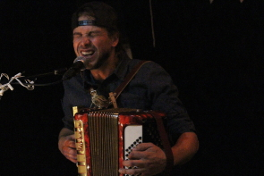 The Mayhemingways Benj Rowland playing accordion at the Windy City Opry, Sept. 13. photo by Richard Amery