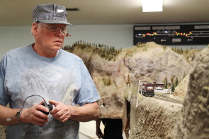 Retired engineer Jean -Yves Brouck runs one of the trains at the Southern Alberta Model Train Club's HO exhibit  during their open house, Oct 21. Photo by Richard Amery