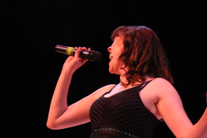 "Erica Hunt belts out ""Put A Little Love In Your Heart "" in Tinsel. Photo by Richard Amery"