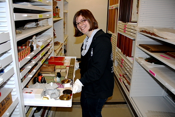 Nicole Hembroff examines a few unusual items in the Galt Museum Collection. Photo by Richard Amery