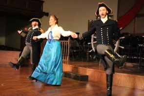 Ben Jaquish, Hannah Nickel and Max Hopkins rehearse a scene from the HMS Pinafore. Photo by Richard Amery