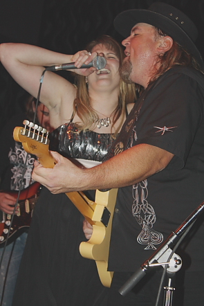 Paul Kype welcomes a guest on stage to sing Zombie with Texas Flood. Photo by Richard Amery