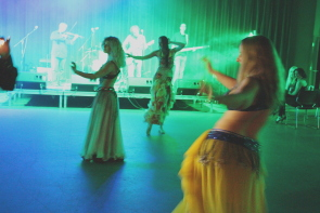 Belly Dancer dance as the Plaid Tongued Devils play Mirsirlou at CASA, June 6. Photo by Richard Amery