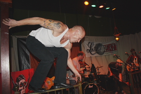 "Popes frontman Paul ""Mad Dog"" McGuinness  does a balancing act on the Slice's rails. Photo By Richard Amery"
