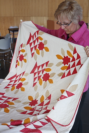 Dawn Hunt shows several different quilts. Photo by Richard Amery