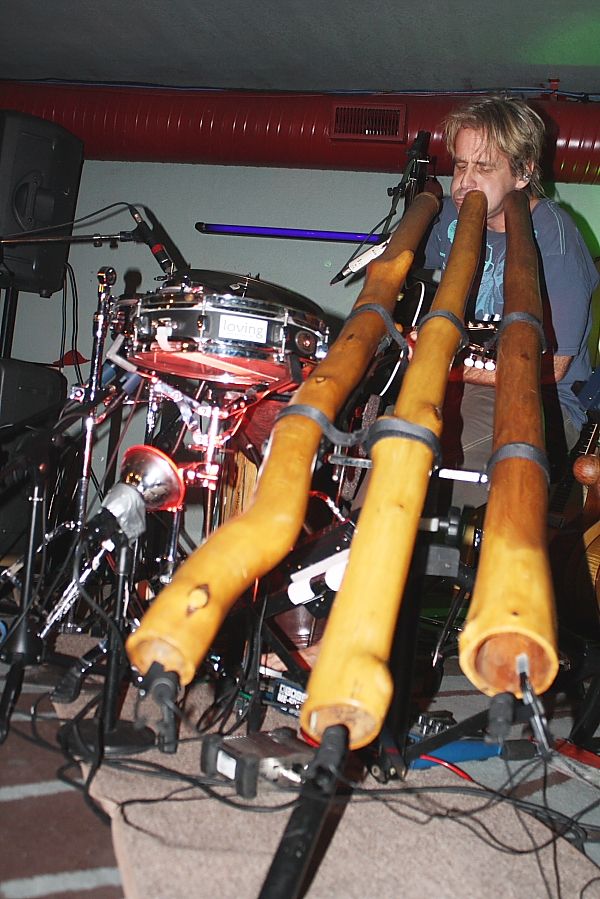 Shane Philip plays a didgeridoo solo. Photo by Richard Amery