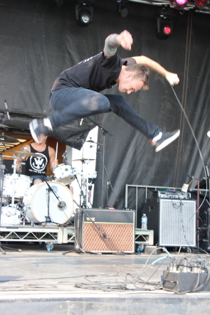 Youngbloods frontman Kyle Hogan takes a giant leap during their Battle of the Band performance, Sunday, Sept. 3. Photo by Richard Amery.