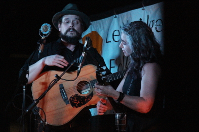 The Small Glories' JD Edwards and Cara Luft play for the Lethbridge Folk Club. Photo by Richard Amery