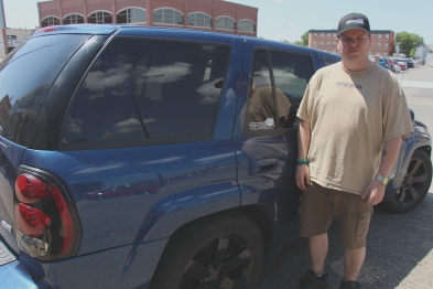 Street Wheelers club president PJ Nadeau with his 'mini-van.' Photo by Richard Amery