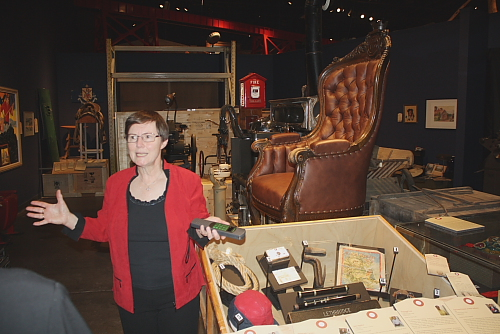 Curator Wendy Aitkens shows off some curiosities and treasures. Photo by Richard Amery