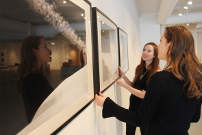 Ildiko Barraclough and Amy Parks set up their exhibit in the Dr. Penny Foster building. Photo by Richard Amery