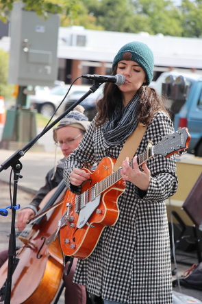 The Junkman's Quire's Megan Brown bundled up during their set at Word on The Street, Sept. 25. photo by Richard Amer